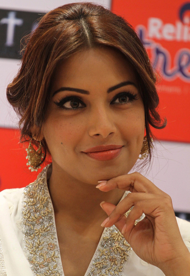 "Bipasha Basu smiles during a press conference to promote her upcoming movie ""Aatma"" in Ahmadabad, India, Friday, March 15, 2013"