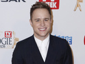 Olly Murs donates a signed trilby hat to the auction, which opens on July 23.