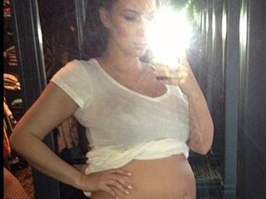 Kim Kardashian shows off her bare baby bump.