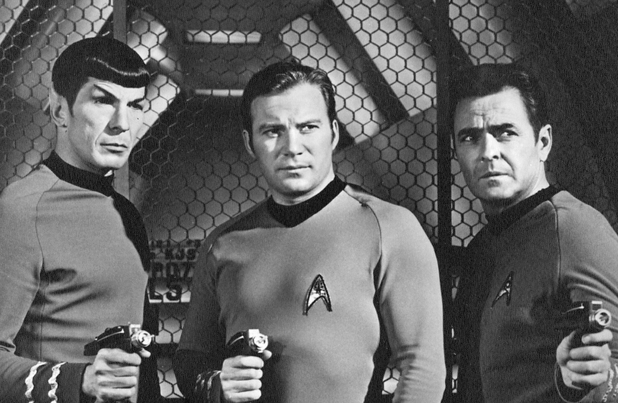 "Leonard Nimoy (as Lt. Cmdr. Spock), William Shatner (as Captain James T. Kirk), James Doohan (as Montgomery Scott ""Scotty"")  on Star Trek"