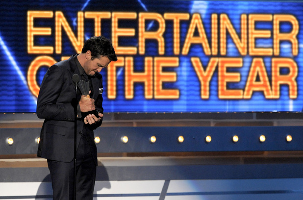 Luke Bryan accepts the award for Entertainer of The Year at the Academy of Country Music Awards 2013