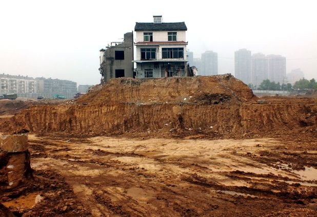 Houses stranded on building site in China