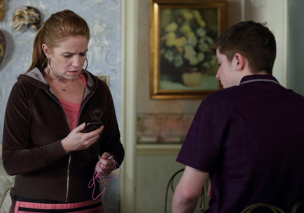 Liam shows Bianca the threatening text messages he's been receiving.