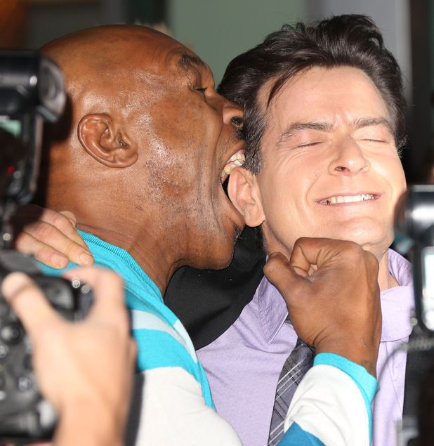 Mike Tyson, Charlie Sheen, bite, pose, red carpet, Scary Movie 5 premiere, Los Angeles