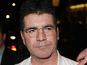 Cowell denies Cole snub: 'We're friends'