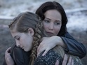 Prim clings tight to sister Katniss in new image from Hunger Games: Catching Fire.