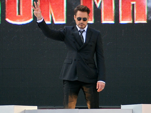 Robert Downey Jr makes an entrance at the 'iron Man 3' premiere in London