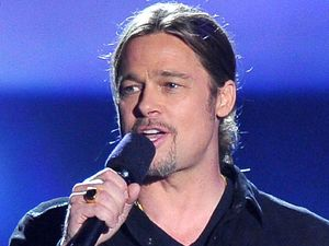 Brad Pitt presents the 'Movie of the Year' award at the MTV Movie Awards 2013