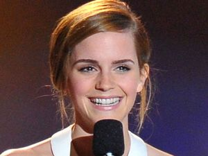 Emma Watson receives her award for Best Female Performance in 'The Perks of Being a Wallflower' at the MTV Movie Awards 2013