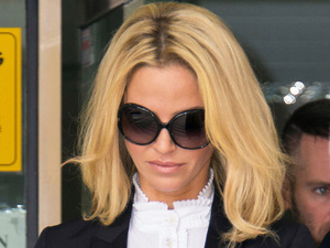 Girls Aloud star Sarah Harding leaves court after being banned from driving for six months.