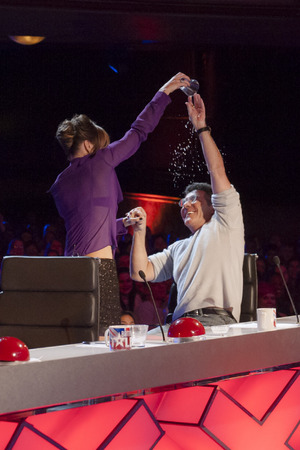 Amanda pours water over Simon's head on Britain's Got Talent episode 2