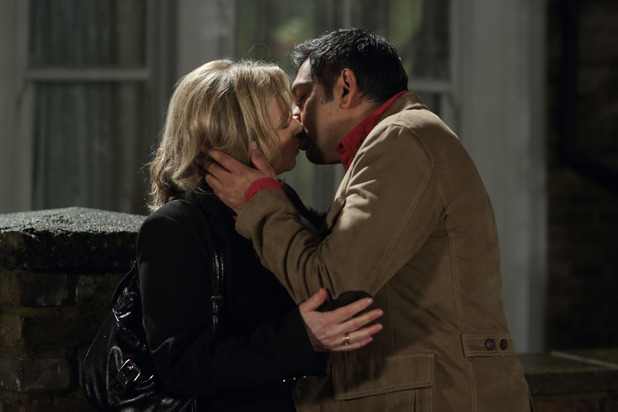 Masood and Carol kiss.