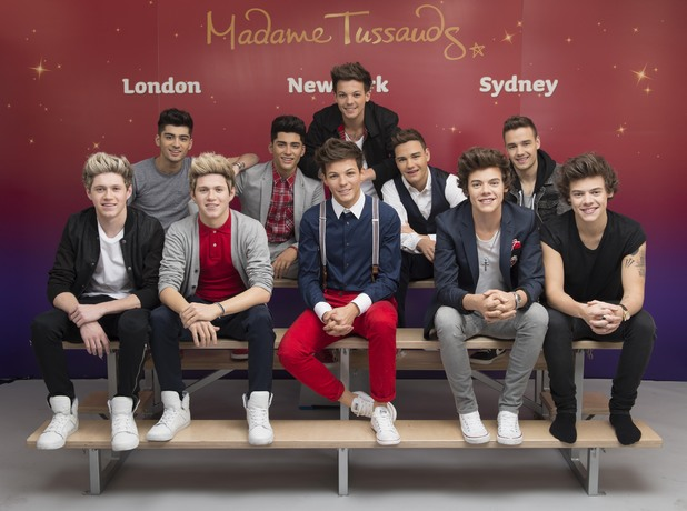 One Direction pose with wax figures at Madame Tussauds
