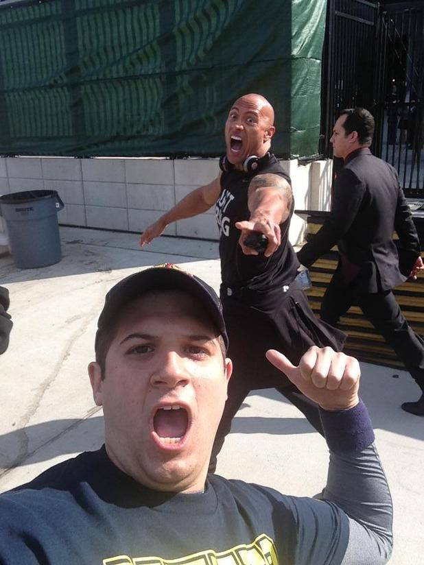 The Rock photobombing