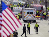 Emergency workers aid injured people at the finish line of the 2013 Boston Marathon following an explosion on  April 15, 2013