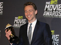 "The Avengers star is ""burdened with glorious popcorn"" for his Loki role."