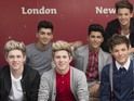 The boyband pose with the sculptures ahead of today's official unveiling in London.