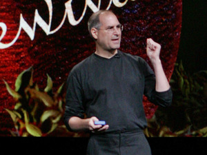 "Apple Computer Inc. CEO Steve Jobs gestures as he shows an episode of the hit television show ""Desperate Housewives"", during an unveiling of an new iPod that will show television episodes on October 12, 2005"
