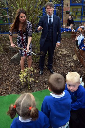 Duchess of Cambridge, John Bishop, Kate Middleton, plants a willow tree with comedian John Bishop at The Willows Primary School
