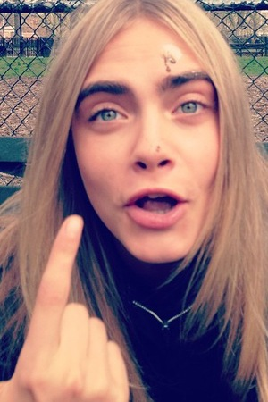 Cara Delevingne gets pooed on by a bird