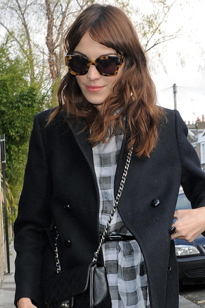 Alexa Chung leaving a Vogue magazine seminar and returning home