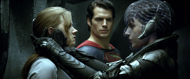 Amy Adams as Lois Lane, Henry Cavill as Superman and Antje Traue as Faora in Man of Steel.
