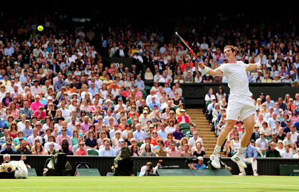 Great Britain's Andy Murray in action against Switzerland's Roger Federer in their Men's Singles Final during day thirteen of the 2012 Wimbledon Championships.