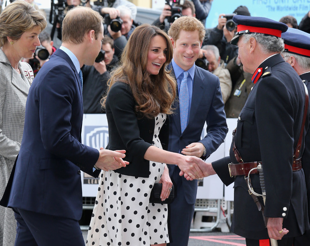 The Duke and Duchess of Cambridge and Prince Harry arrive for their visit to Warner Bros studios in Leavesden
