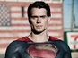 Henry Cavill stands in front of the Stars and Stripes in new Superman still.