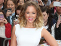 "The Girls Aloud star says she is ""a little bit busy"" to start a family now."