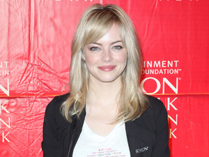 Emma Stone kickstarts the Annual Entertainment Industry Foundation Revlon Run/Walk for Women in Times Square.