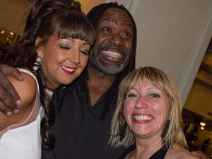 Reginald D Hunter poses for photos after the PFA awards