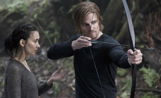 Celina Jade as Shado and Stephen Amell as Oliver Queen in Arrow S01E20: 'Home Invasion'