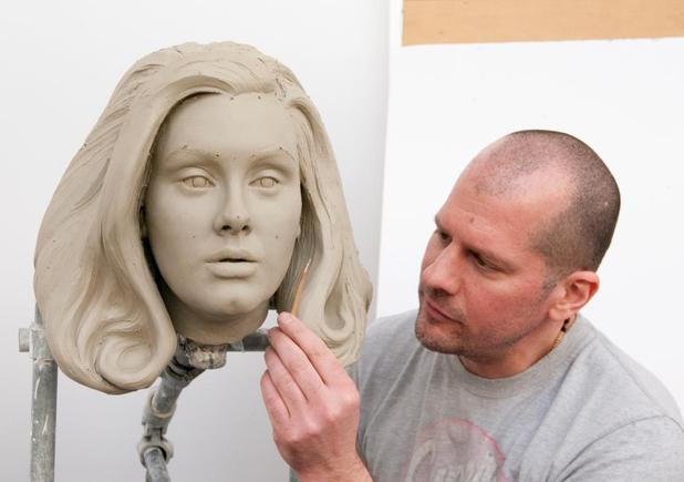 Sculptor Louis Wiltshire works on the clay model for singer Adele's waxwork figure.