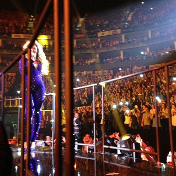 Kim Kardashian takes a photo of Beyonce in concert
