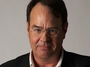 Dan Aykroyd with Crystal Head Vodka bottle