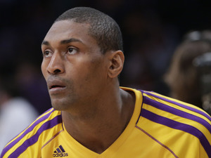 Los Angeles Lakers' Metta World Peace looks on during practice for an NBA basketball game against the Houston Rockets in Los Angeles, Wednesday, April 17, 2013.