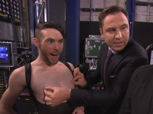 David Walliams tweaks the nipples of a member of The Glambassadors