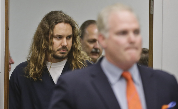 Tim Lambesis, the lead singer for the Metal band As I Lay Dying, follows his attorney into Superior Court for his arraignment on charges he allegedly attempted to hire a hit man to kill his wife in Vista, Calif., Thursday, May 9, 2013.
