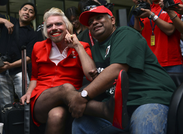 Richard Branson dresses as an air hostess after losing a bet with AirAsia's Chief Executive Tony Fernandes