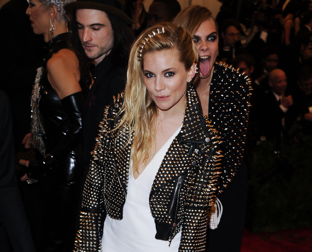 Sienna Miller, Cara Delevingne, photobomb, met ball 2013, Costume Institute Gala Benefit celebrating the Punk: Chaos To Couture exhibition, Metropolitan Museum of Art, New York
