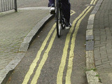 Double yellow lines down a cycle path