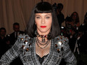 54-year-old star looks dramatic in a cropped black wig and a studded tartan blazer.