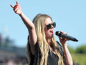 "Avril Lavigne performs at KIIS FM's ""Wango Tango 2013"" at the Home Depot Center on Saturday, May 11, 2013 in Carson, Calif."