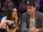 The couple and Mila Kunis's parents take in a stage play in London.