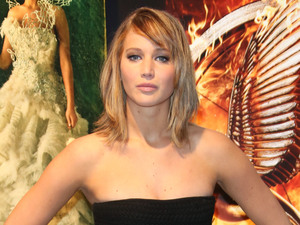Jennifer Lawrence arrives for the photocall of The Hunger Games: Catching Fire&#39;.