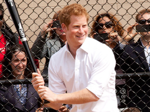 Prince Harry, participates in the Harlem RBI baseball game on the Field of Dreams in Manhattan