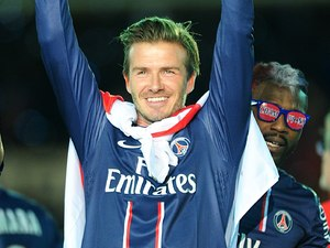 David Beckham celebrates with the French Ligue One Trophy.