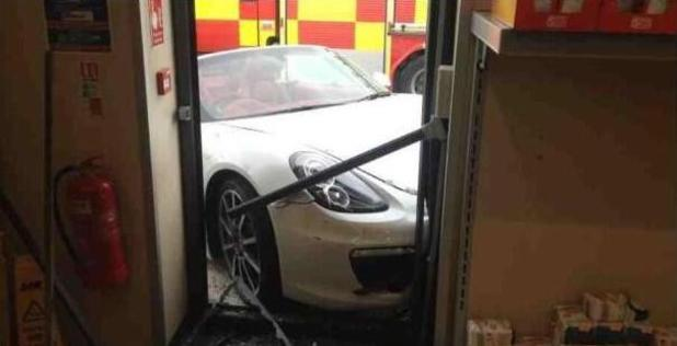 Porsche crashes into Aldi supermarket