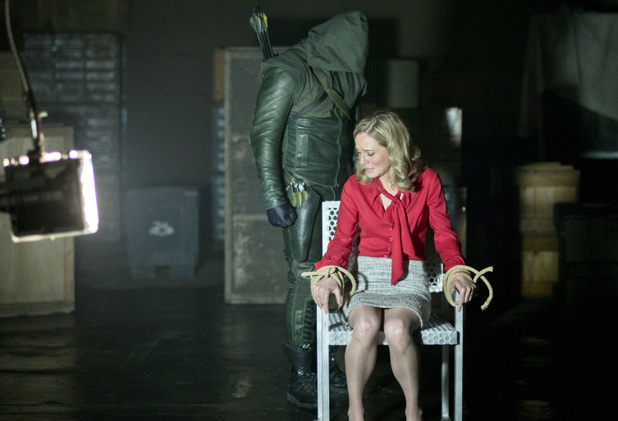 Stephen Amell as The Arrow and Susanna Thompson as Moira Queen in Arrow S01E22: 'Darkness on The Edge of Town'